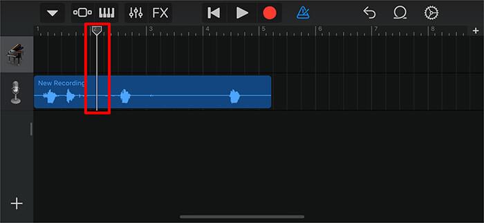 Ziehen Sie die lange vertikale Leiste, um einen Teil der Sprachnotiz in der GarageBand-App zu trimmen