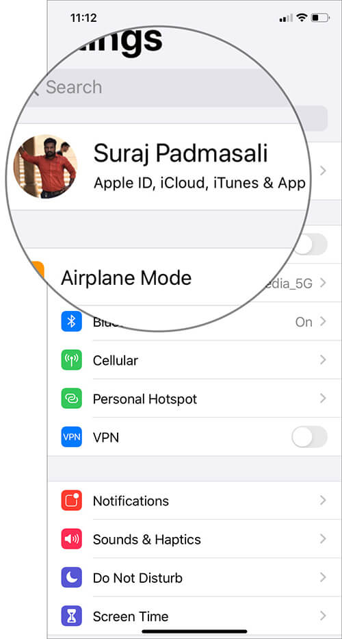 Open Settings and tap on your name card on iPhone