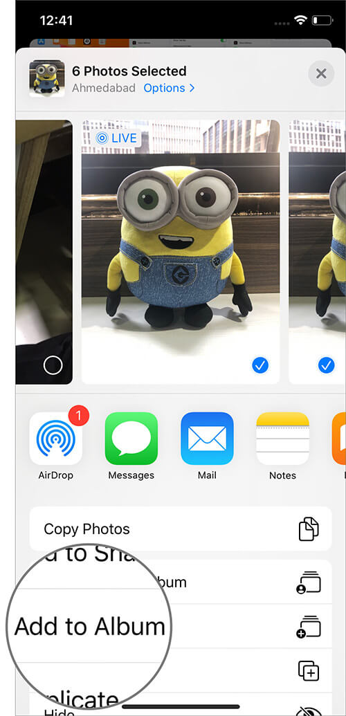 Select Option to Add Photos to Album on iPhone in iOS 13