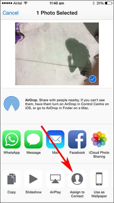 Tap Assign to Contact in iPhone Photos App Share Sheet