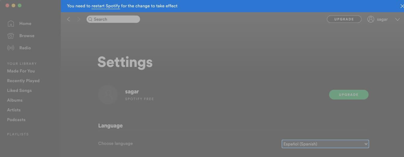 click on restart spotify to change language on desktop