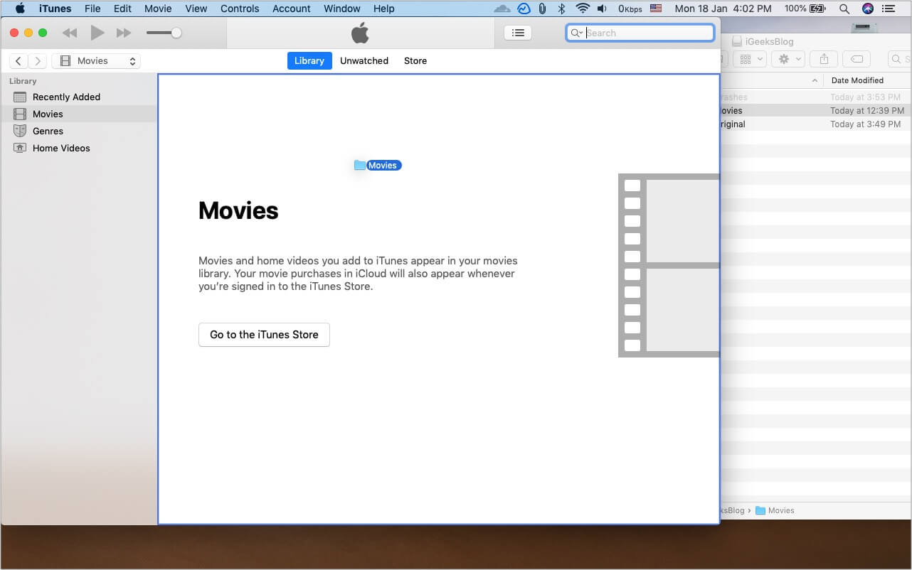 Press and hold Option key and drag Movies folder from external drive to iTunes