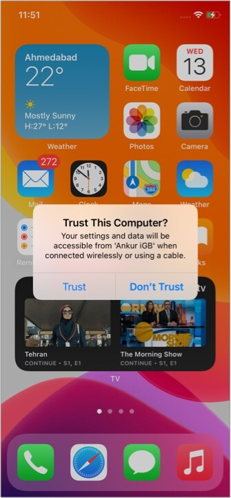 Tap Trust on your unlocked iPhone