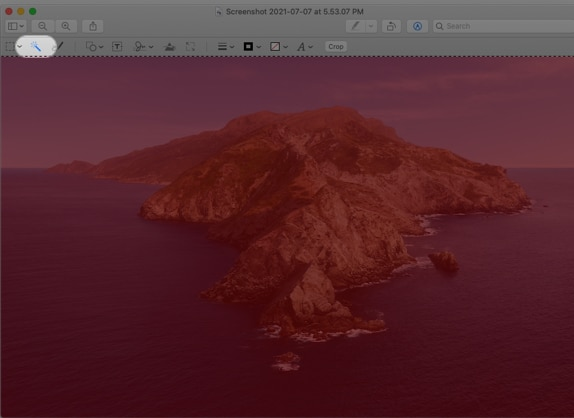 Click the Instant Alpha tool on Mac Preview
